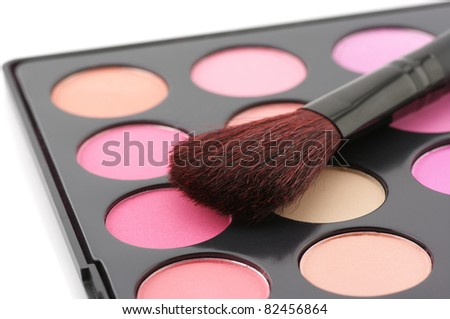 Palette of colorful blushes and brush on white background. - stock photo