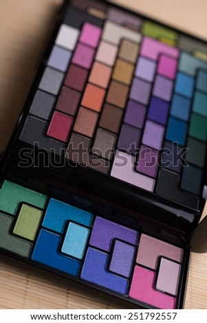 Palette of professional colorful eye shadows. Selective soft focus. - stock photo