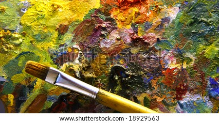 palette with paintbrush - stock photo