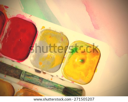 Palette with water color paints and brush for drawing. - stock photo