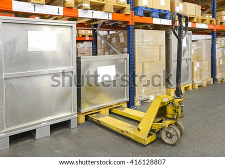 Pallet Jack Truck in Distribution Warehouse - stock photo