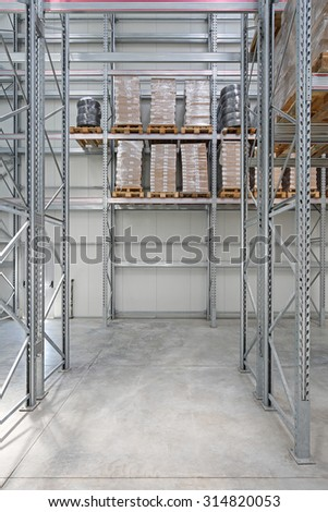 Pallet Rack With Goods in Distribution Warehouse - stock photo