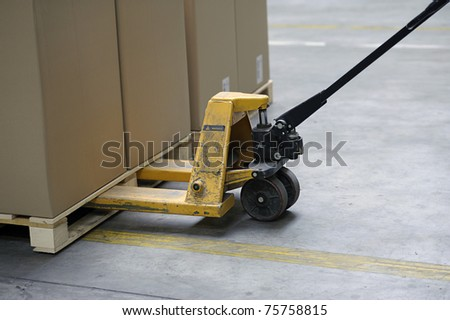 pallet truck with carton boxes - stock photo
