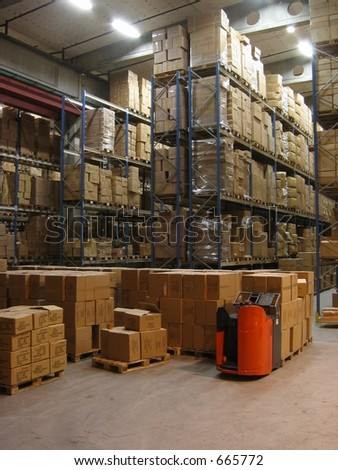 Pallets, shelves and a truck in a warehouse - stock photo