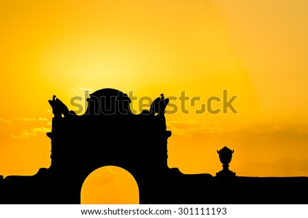 Palm and tropical trees silhouette on sunset tropical beach. Vacation background. - stock photo