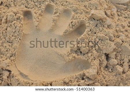 palm print in sand - stock photo