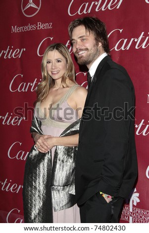 PALM SPRINGS - Jan 6:  Mira Sorvino and husband Christopher Backus attend the 20th Palm Springs Film Festival Gala on January 6, 2009 in Palm Springs, California. - stock photo