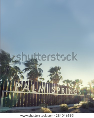 Palm Springs sign - epic sky and sun-flare copy space area - stock photo