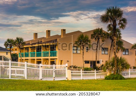 Palm trees and beachfront hotel at St. Augustine Beach, Florida. - stock photo