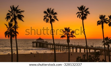 Palm trees on Manhattan Beach at sunset, Los Angeles - stock photo