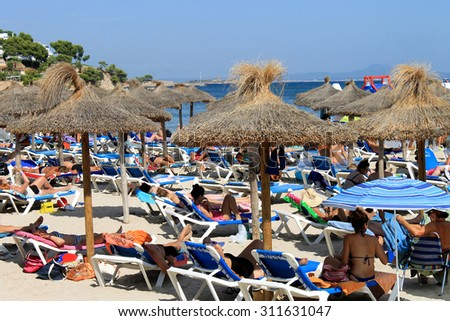 PALMA NOVA BEACH, MAJORCA, SPAIN - 25th August 2015: Palma Nova beach resort on the 25th August 2015. This is a popular and established tourist destination every summer. - stock photo