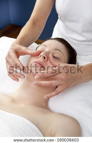 palming massage at the beauty salon - stock photo