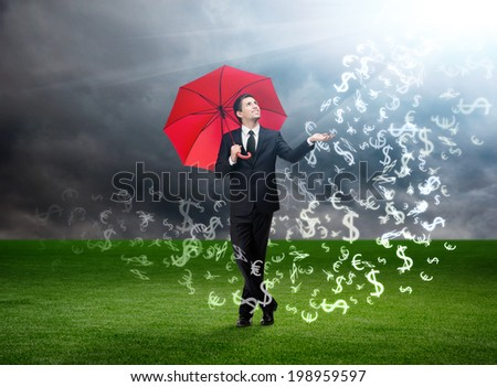 Palming up man with opened umbrella looks at currency signs falling from the sky on stormy background - stock photo