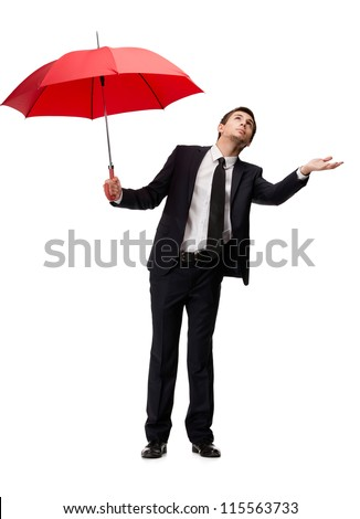 Palming up man with red umbrella checks the rain, isolated on white - stock photo