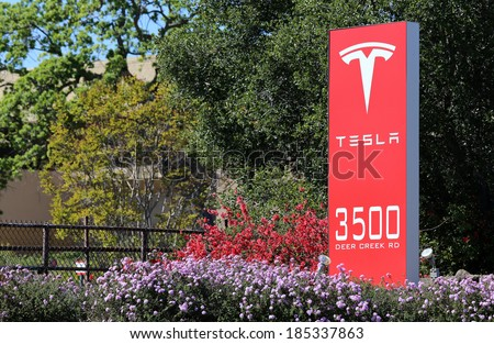 PALO ALTO, CA - MARCH 18: The Tesla Motors World Headquarters located in Palo Alto on March 18, 2014. Tesla Motors is an American company that designs, manufactures and sells electric cars. - stock photo