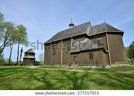 Paluse wooden church in the Aukstaitija National Park in Lithuania.The church of Paluse, built in 1750, is considered to be the oldest surviving wooden church in Lithuania - stock photo