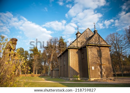 Paluse wooden church. Paluse is a tourist village in the Aukstaitija National Park in eastern Lithuania. It is located south-west of Ignalina. The church of Paluse was built in 1750. - stock photo