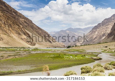Pamir highway in Wakhan coridor next to Panj river (Amu Darya). Marco Polo silk road. Gorno Badakhsan province, Tajikistan, Central Asia - stock photo