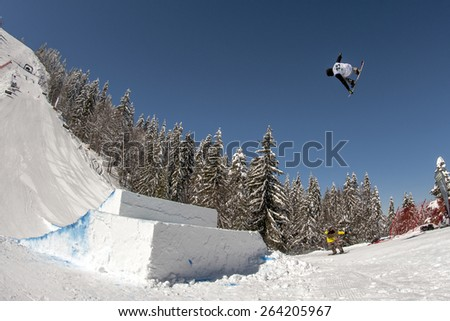 "PAMPOROVO,BULGARIA - MARCH 17 : Competitor performs trick during the ""Pamporovo Freestyle Open 14-19 March 2015"" in Pamporovo,Bulgaria on March 17, 2015 - stock photo"