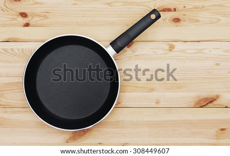 Pan on wooden background - stock photo