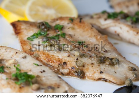 Pan seared catfish meuniere with capers and lemons  - stock photo