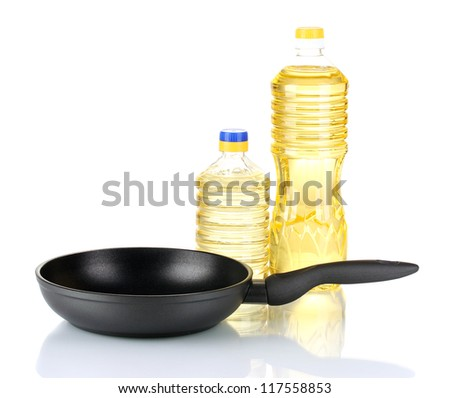 Pan with bottle of oil isolated on white - stock photo