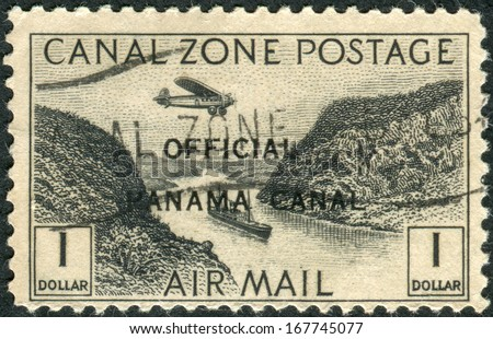 PANAMA CANAL ZONE - CIRCA 1931: Postage stamp printed in Panama Canal Zone (overprint), shows artificial valley Culebra Cut, circa 1931 - stock photo