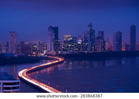 Panama City, Central America, view of Costa Del Este and Corredor Highway at night, with traffic jam of cars and vehicles - stock photo
