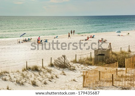PANAMA CITY, FL - FEB. 22, 2014:  Beach goers enjoy beach and blue water of the Gulf of Mexico.  Panama City Beach is a very popular spring break destination during March and April. - stock photo