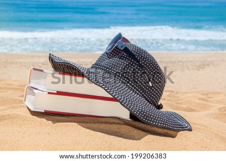 Panama on the books for reading on the beach. Sunglasses for protection. - stock photo