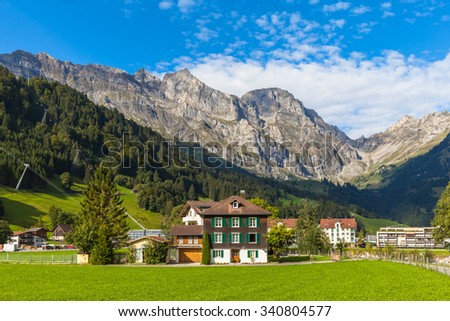 Panaroma view of the Alps in the valley of Engelberg on a summer morning, canton of Obwalden, Switzerland. - stock photo