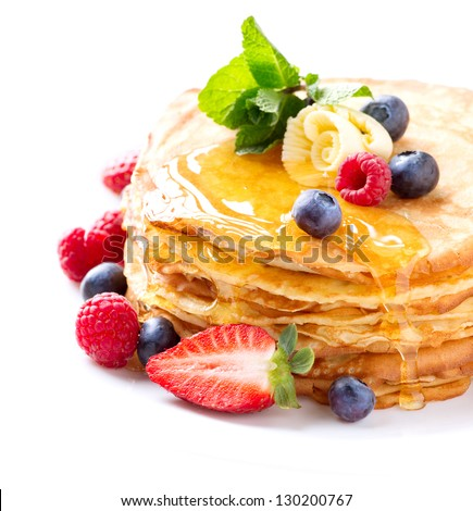 Pancake. Crepes With Berries. Pancakes stack with Strawberry, Raspberry, Blueberry and Syrup isolated on a White Background - stock photo