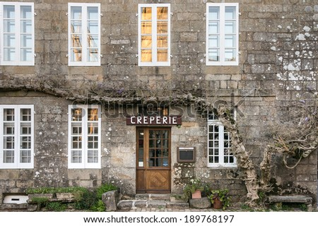 Pancake restaurant facade with sign, Locronan, Brittany, France - stock photo