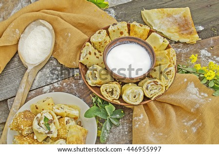 Pancake rolls with yogurt dip.  Healthy homemade  breakfast - stock photo