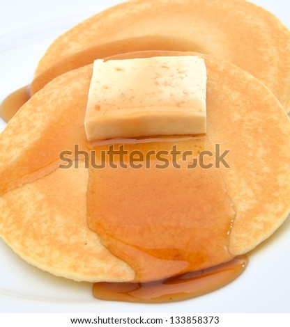 Pancake with honey and cream. - stock photo