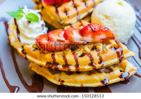 Pancake with strawberry on top and icecream - stock photo
