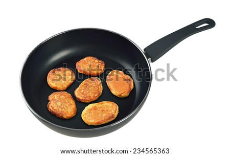 Pancakes in a frying pan. Isolated on white background. - stock photo