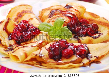 pancakes on plate with sweet cherry confiture - stock photo