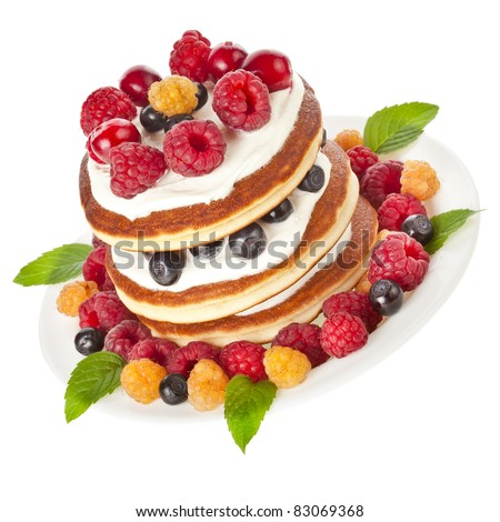 Pancakes stack with fresh berries  on white background - stock photo