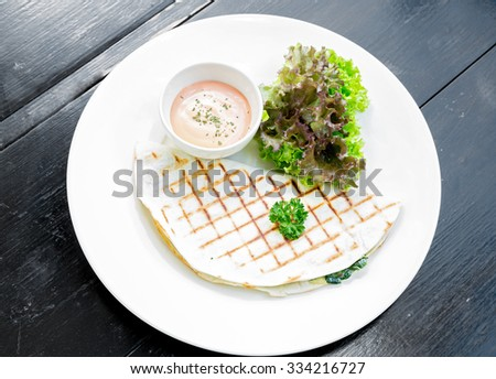 pancakes stuffed with the spinach - stock photo