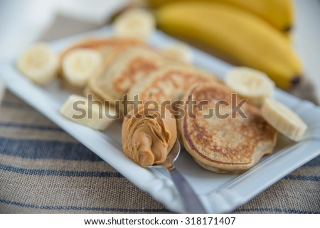 pancakes with banana and peanut butter - stock photo