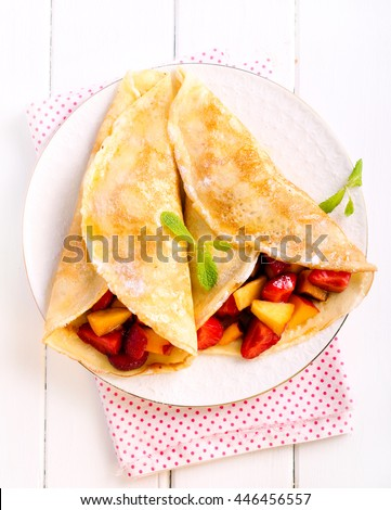 Pancakes with berry and fruit filling, top view - stock photo