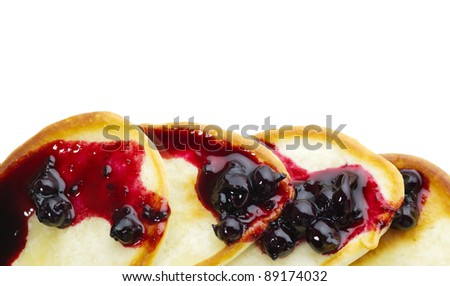 pancakes with blackcurrant jam on a white background - stock photo