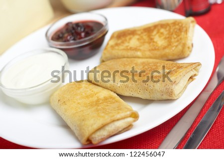 Pancakes with cheese and jam - stock photo