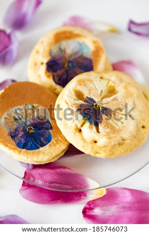 pancakes with flowers - stock photo