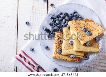 Pancakes with fresh blueberries.selective focus.  - stock photo