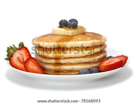 pancakes with fruits, butter and syrup isolated over white background - stock photo