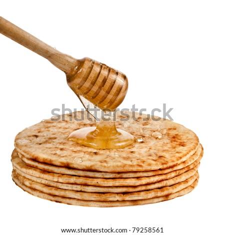 pancakes with honey isolated on white - stock photo