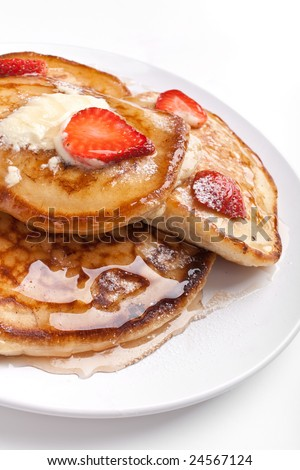 pancakes with maple syrup, melted butter and strawberries - stock photo
