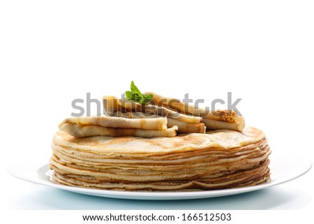 pancakes with mint on a white background - stock photo